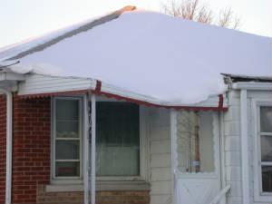 snow covered roof inspection in Chicago